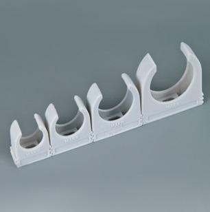 Клипсы, соединенные в одну систему для одновременной фиксации нескольких труб